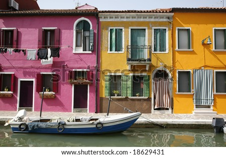 Colorful houses on the island of Burano in the Venetian lagoon - Italy.