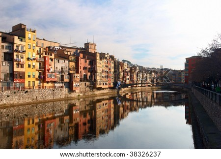 Colorful houses on the river bank and its reflection in water