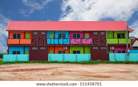 Colorful houses on vacant land.