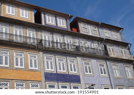 Colorful houses with azulejo facades in Porto, Portugal - stock photo