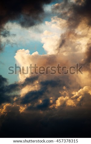Colorful huge clouds a blue sky background at sunset. Magnificent tropical sunset colors clouds in magical colors. - stock photo
