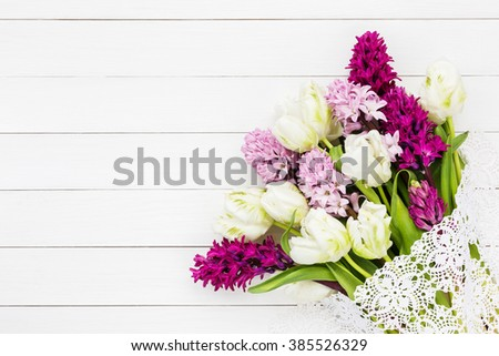 Colorful hyacinth flowers on white wooden background. Top view, copy space