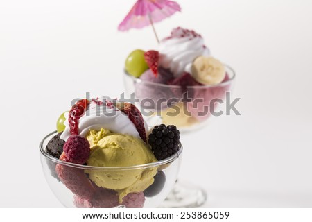 colorful ice cream cup with fruits for the hot summer days - stock photo