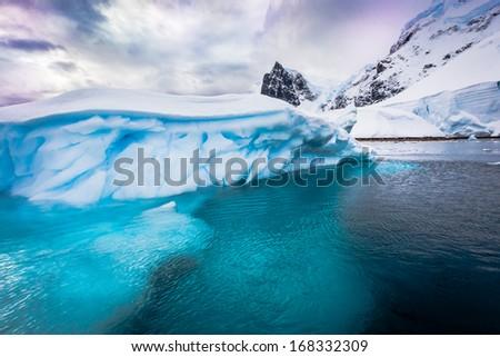 Colorful iceberg near Andvord Bay in Antarctica. - stock photo
