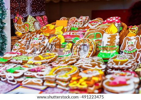 Colorful icing on the handmade gingerbreads displayed at the Christmas market in Riga, Latvia. Traditional sweets presented in various shapes, sizes and styles such as horse, cat and Santa.