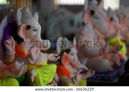 Colorful idols of Lord Ganesha are worshiped during the Ganpati festival in India - stock photo