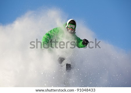 colorful image of young man in a cloud of snow - stock photo