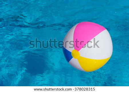 Colorful inflatable ball at the swimming pool
