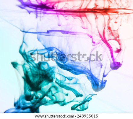 Colorful inks in the water - stock photo