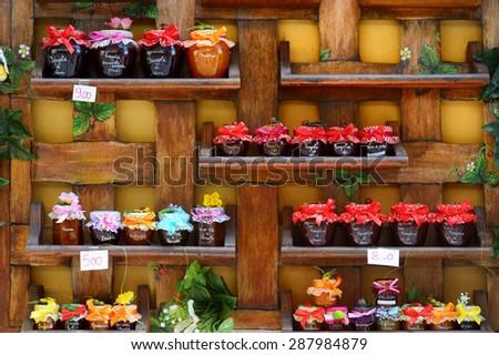 Colorful jam jars arranged for sale in Nemi, Italy - stock photo