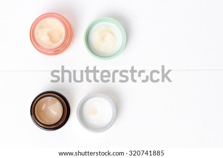 Colorful jars of cosmetic cream - stock photo