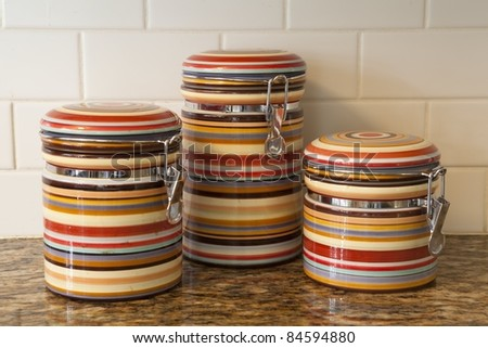 Colorful jars on a counter - stock photo