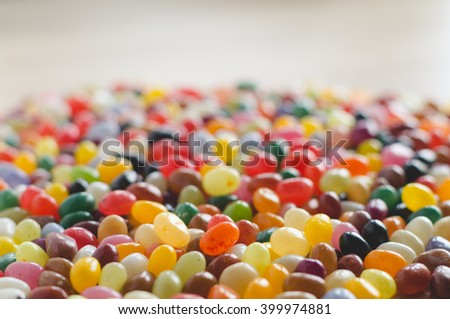 Colorful jelly beans side-view background with selective focus