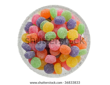 colorful jelly candies in a glass bowl, isolated on white - stock photo
