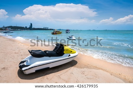 Colorful Jetski on the beach of holiday season,pattaya beach,the most famous beach in thailand - stock photo