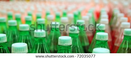 colorful juice beverage plastic bottle in factory line - stock photo