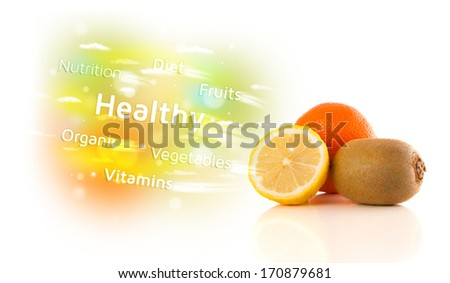 Colorful juicy fruits with healthy text and signs on white background