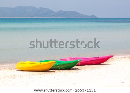 colorful kayak on beach - stock photo