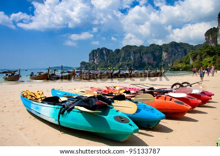 Colorful Kayaks at the tropical beach - stock photo