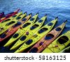 Colorful kayaks lined up - stock photo