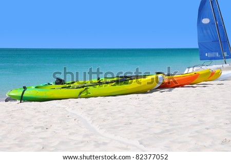 Colorful kayaks on the ocean beach. - stock photo