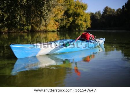Colorful kayaks on the tropical beach. - stock photo