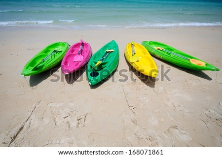Colorful kayaks on the tropical beach in Thailand - stock photo