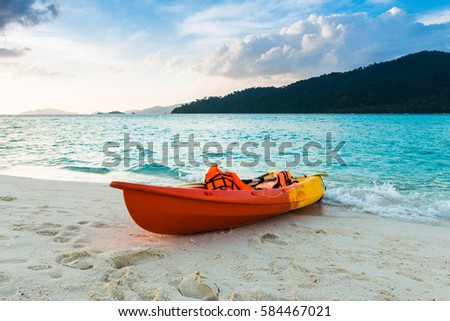 Colorful kayaks on the tropical beach, Sunset,Thailand.