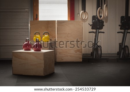 colorful kettlebells on cross fit boxes - stock photo