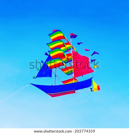 colorful kite flying in the sky - stock photo