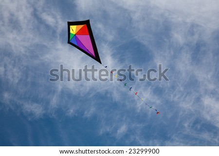 Colorful kite flying in the sky. - stock photo