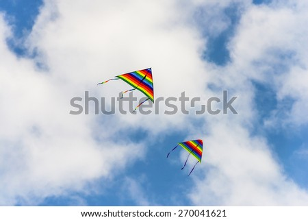 colorful kite flying in the wind - stock photo