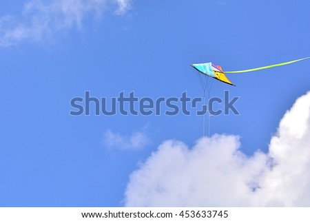 Colorful kite in the blue sky.