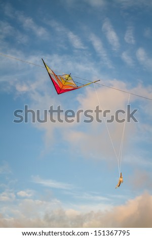 colorful kite tangled in Electrical wires against the evening sky
