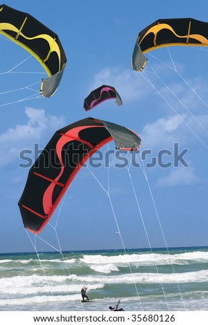 colorful kiteboarding kites - stock photo