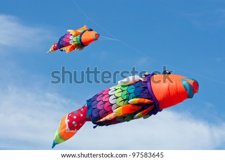 Colorful kites on blue sky. - stock photo