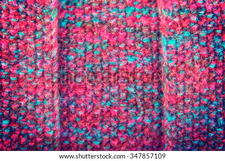 Colorful knitted wool background. The combination of yellow, red, purple, brown thread. - stock photo