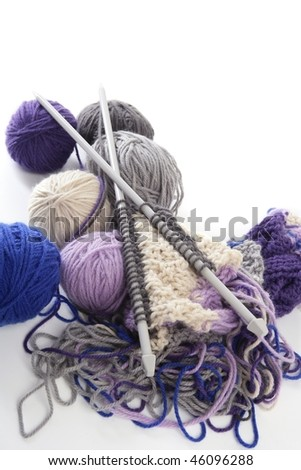 colorful knitting tools with wool thread balls - stock photo