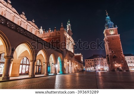 Colorful Krakow Night. Cracow Old Town Main Market Square. Krakow, Poland, Europe. - stock photo