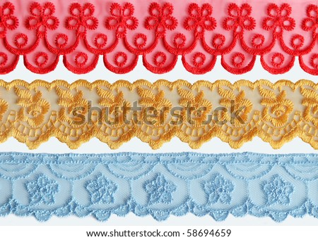 Colorful Lace Fabric on white background - stock photo