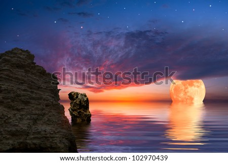 Colorful landscape with big moon and rock at the ocean, sky reflected in water - stock photo
