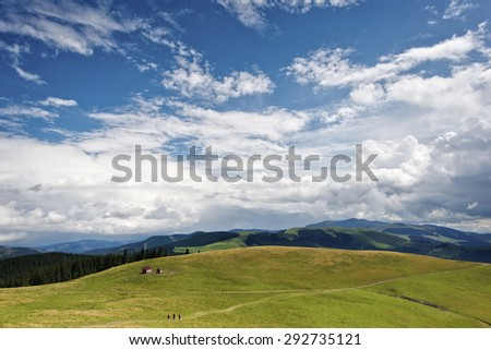 Colorful landscape with blue cloudy sky in the carpathian mountains, Romania