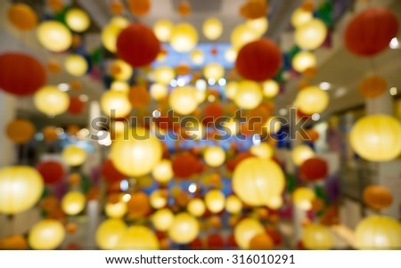 Colorful lantern lamp in shopping mall blurred