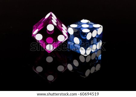 Colorful Las Vegas Gambling Dice isolated on a black background. - stock photo