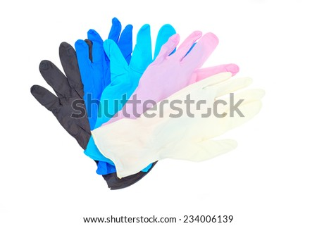 Colorful latex gloves isolated - stock photo