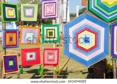 Colorful lattice patterns made of embroidery threads - stock photo
