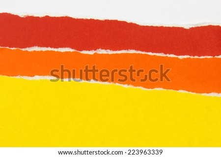 colorful layers of torn paper  - stock photo