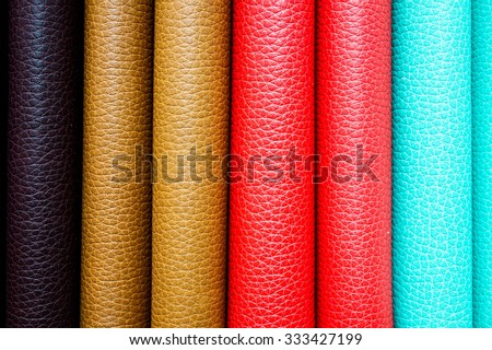 Colorful leather binding of stacked books, as a background image - stock photo
