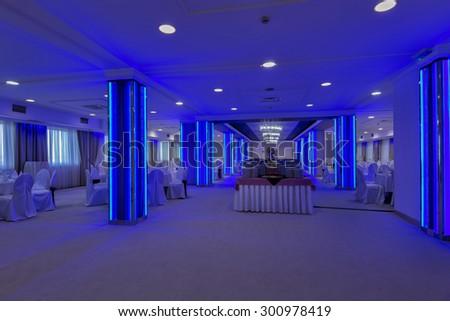 Colorful led lightning in wedding hall - stock photo