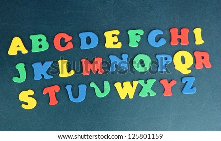 Colorful letters on school board close-up - stock photo